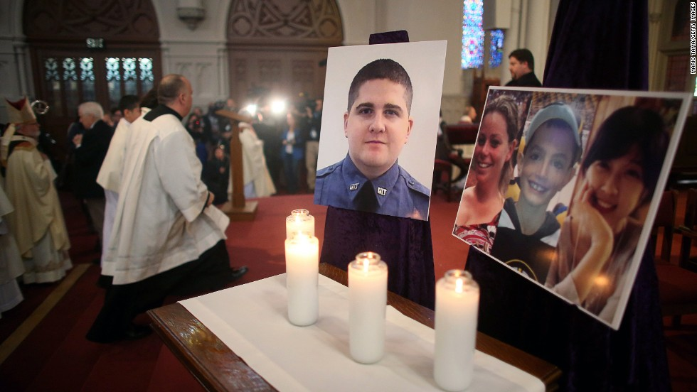 Photos of the deceased are displayed in Boston at the Cathedral of the Holy Cross on April 21, 2013.