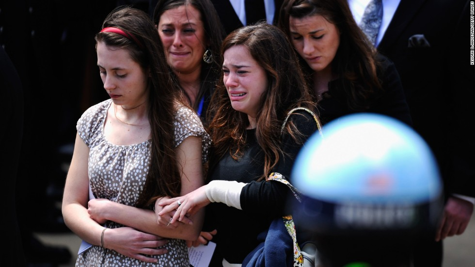 Mourners walk out of St. Joseph Catholic Church after Campbell's funeral service.