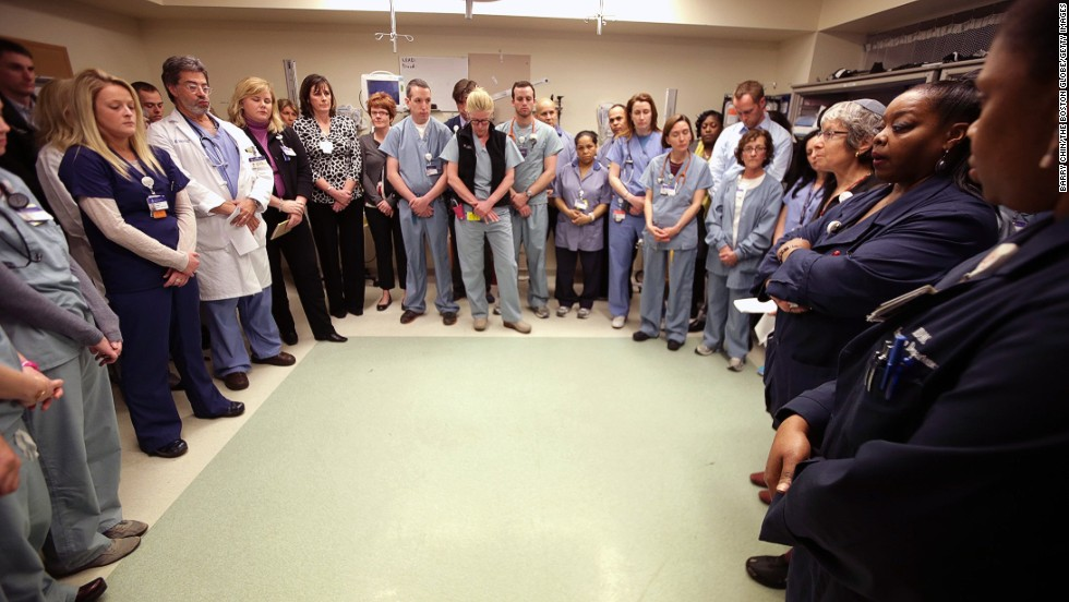 Staff of the Beth Israel Deaconess Medical Center Emergency Department gather inside a trauma room on April 22, to observe a moment of silence for victims in the Boston Marathon bombings.