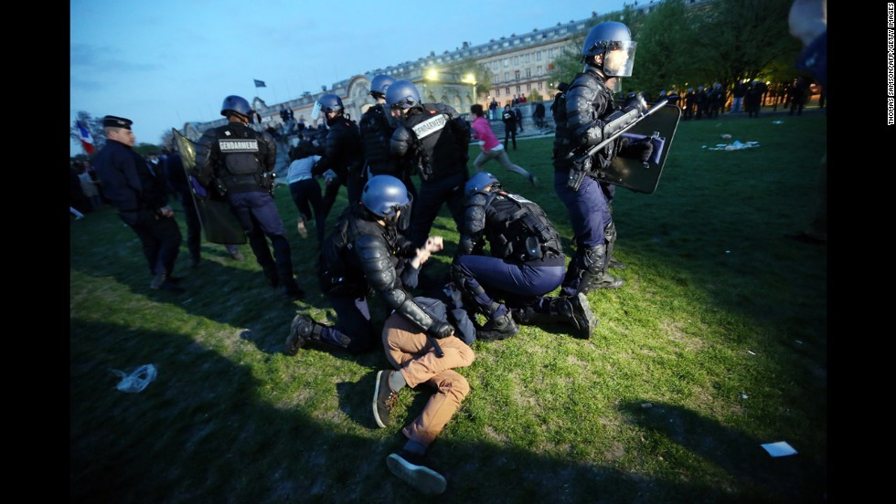 "Police officers hold down a demonstrator at the ""La Manif Pour Tous"" demonstration on Sunday."