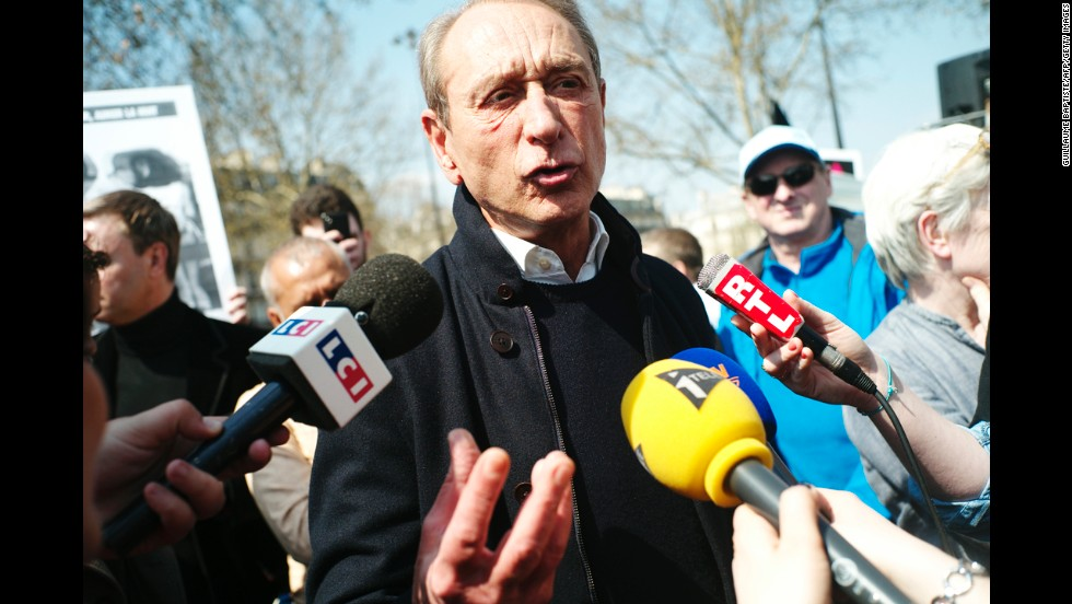 Paris Mayor Bertrand Delanoe speaks to journalists at Bastille Square during a pro-gay rights demonstration on Sunday.