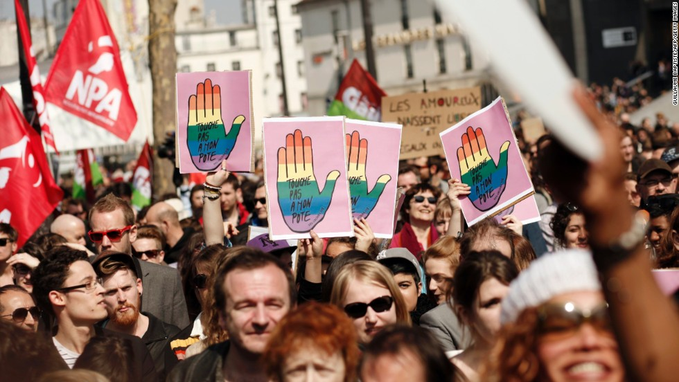 Gay marriage supporters raise signs in Bastille Square on Sunday.