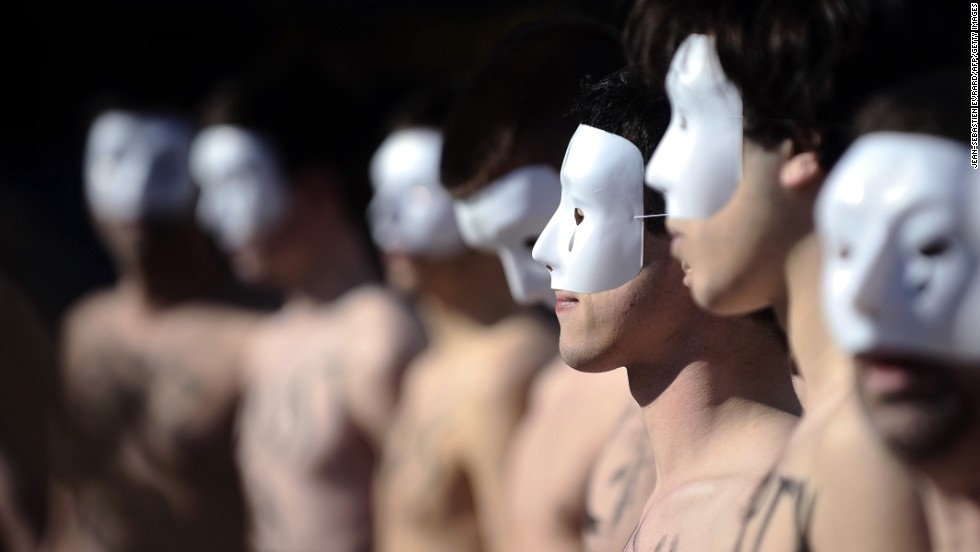 Members of the anti-gay marriage group Hommen demonstrate on Saturday, April 20, in Rennes, France. The group was created in response to Femen, a feminist group that organizes topless protests for social issues.