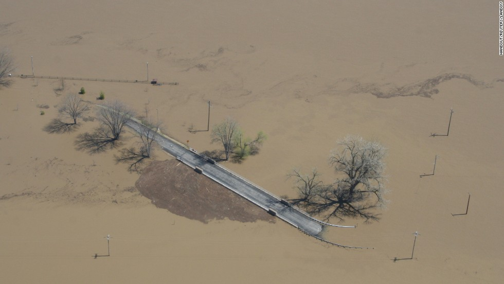 Flooding inundates a road along the Mississippi River north of Clarksville, Missouri, on Sunday, April 21, in a handout photo from the Missouri governor's office.