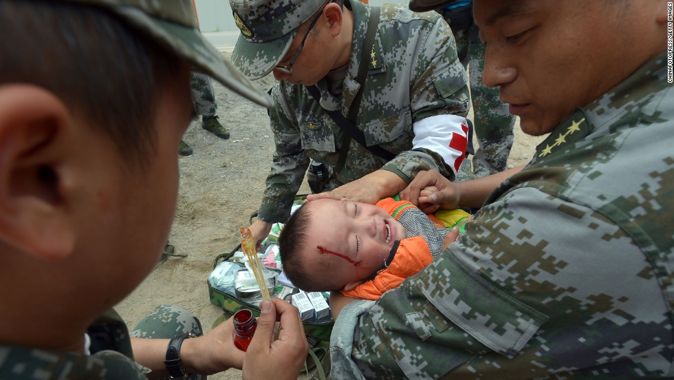 An injured boy receives treatment on Monday.