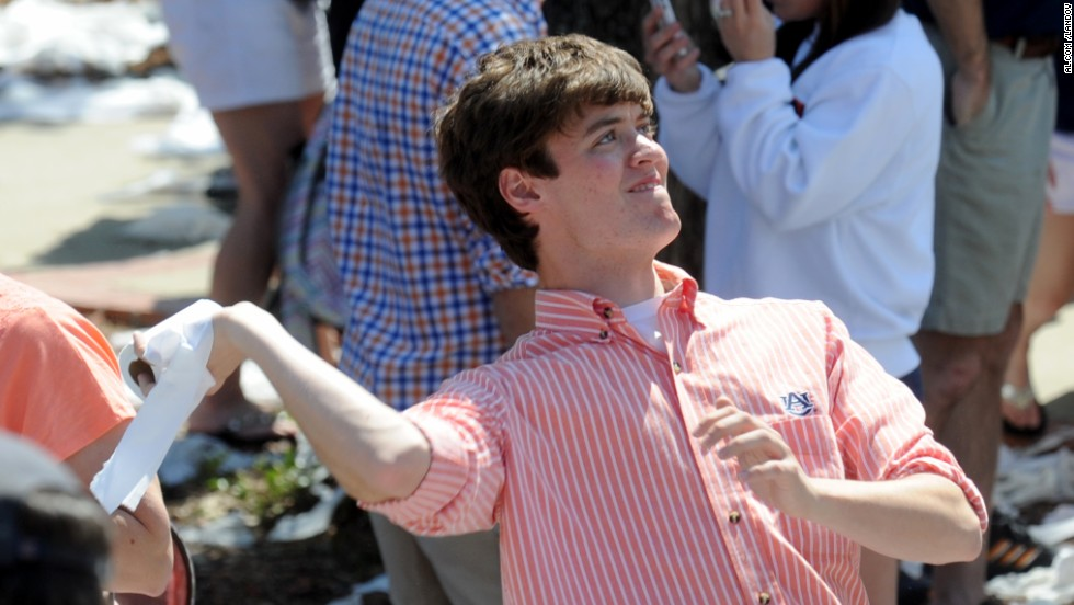 An Auburn fan prepares to fling a roll on Saturday.