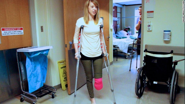 Adrianne Haslet-Davis, a dance instructor, walks in her hospital room at Boston Medical Center, April 22, 2013. She and her husband were among the more than 170 victims injured at the Boston Marathon last Monday. Surgeons were forced to amputate part of her leg, five inches below her left knee.