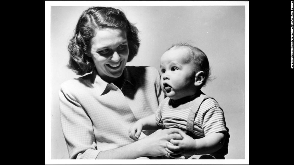 Barbara Bush holds George W. Bush, circa 1947.
