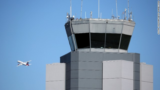 A plane takes off past the control tower at San Francisco International Airport on February 25.