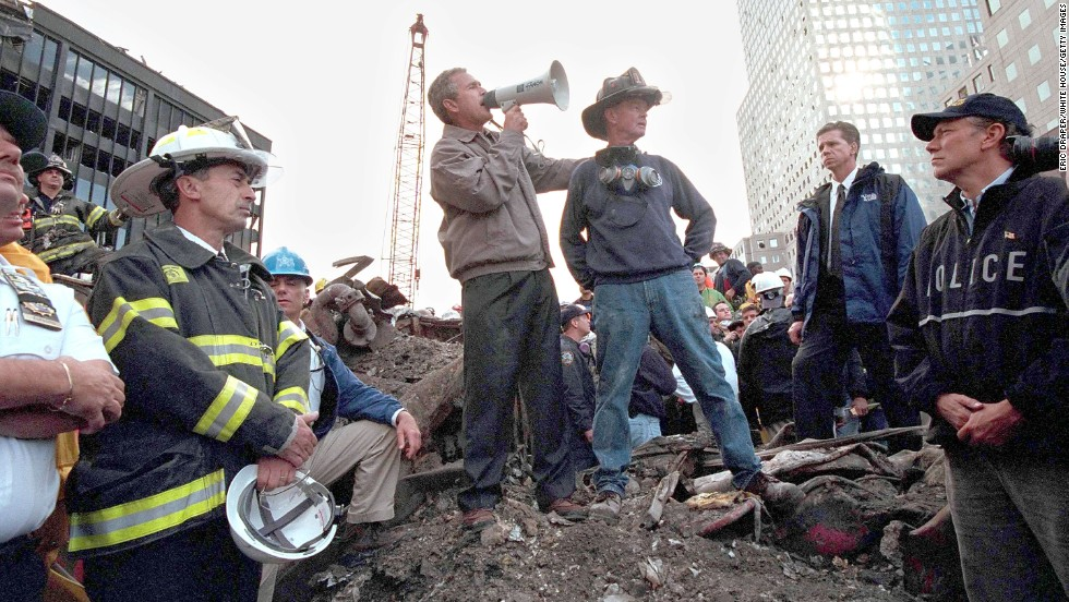 George W. Bush speaks to rescue workers, firefighters and police officers at the rubble of ground zero three days after the September 11, 2001, attacks.
