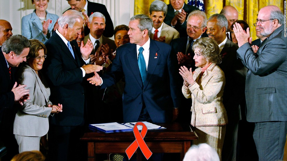 George W. Bush shakes hands with then-Sen. Joe Biden after signing the United States Global Leadership Against HIV/AIDS, Tuberculosis and Malaria Reauthorization Act in July 2008.