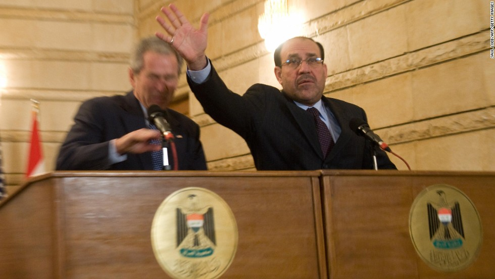 Iraqi Prime Minister Nuri al-Maliki tries to block shoes thrown by an Iraqi man at George W. Bush during a joint news conference in Baghdad in December 2008.