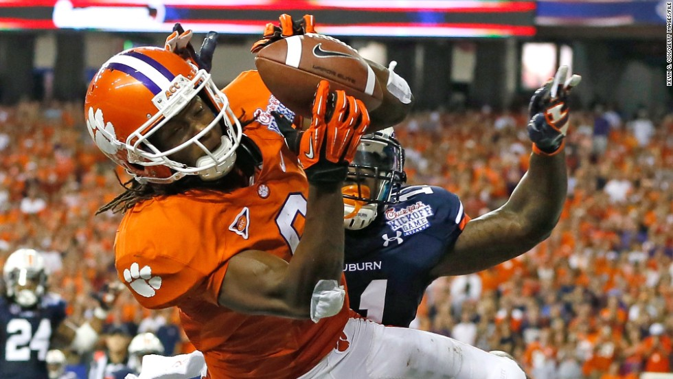 DeAndre Hopkins of the Clemson Tigers catches a touchdown pass over Chris Davis of the Auburn Tigers at the Georgia Dome on September 1, 2012, in Atlanta.