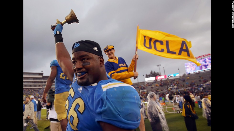 Defensive end Datone Jones of UCLA celebrates a victory over the USC Trojans at the Rose Bowl on November 17, 2012, in Pasadena, California.