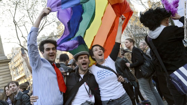 People celebrate in Paris on April 23, 2013, after the French National Assembly adopted a bill legalizing same-sex marriages.