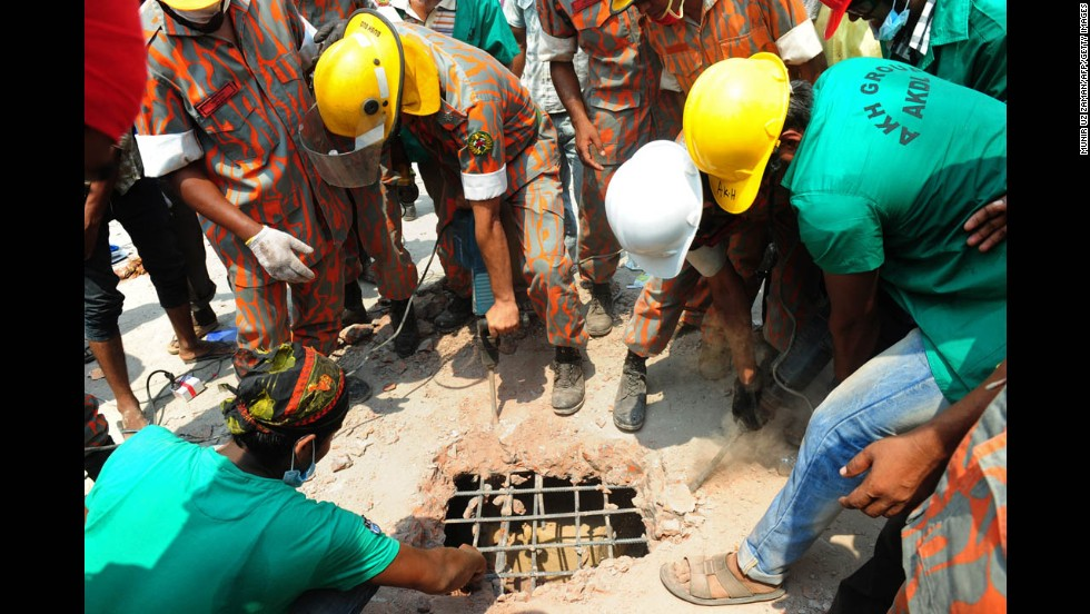 Bangladeshi firefighters cut a hole through concrete during rescue operations on April 25 in Savar, a suburb of Dhaka.