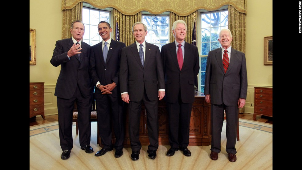 Presidents George H. W. Bush, left, Barack Obama, George W. Bush, Bill Clinton and Jimmy Carter pose for a photograph in the Oval Office on January 7, 2009.