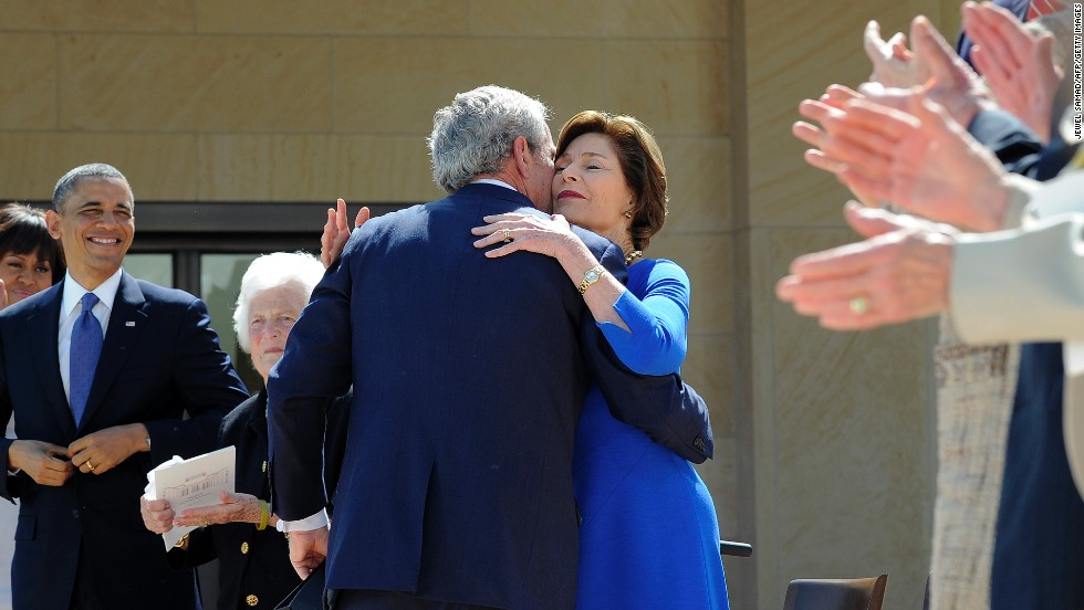 George W. Bush hugs his wife Laura after speaking.