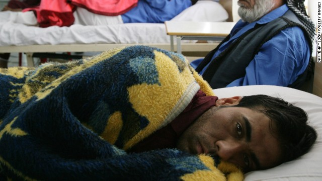 Wounded Iraqi men rest at a hospital in the northern Iraqi city of Arbil on April 25, 2013.