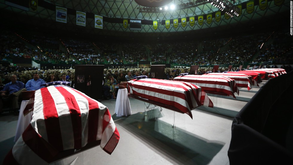 Coffins containing the remains of victims from the fertilizer plant explosion in the town of West, Texas, at a memorial on April 25.