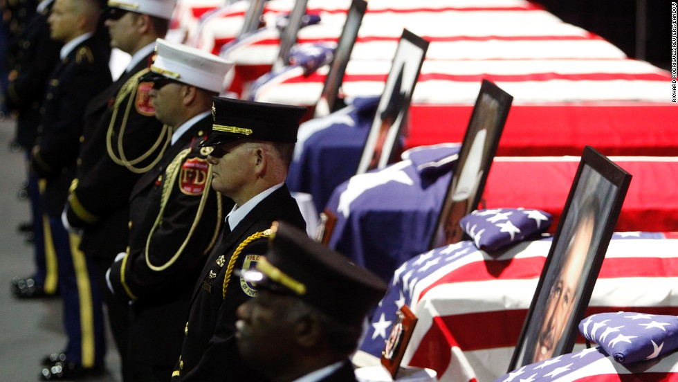 A firefighters honor guard stands before the coffins of fallen comrades on April 25.