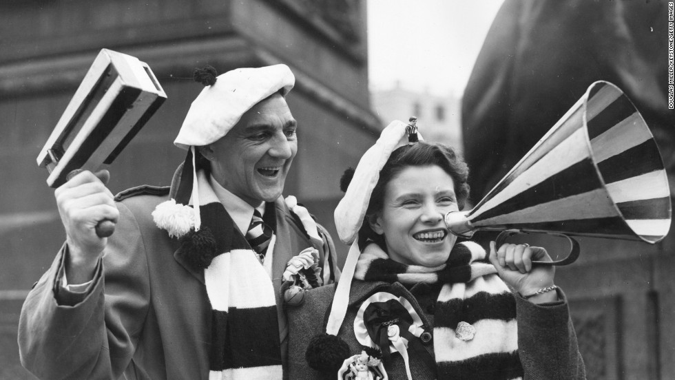 These happy fans are on their way to the English FA Cup final in 1952 but they would not be allowed to support their team using rattles or loudhailers at many global stadiums today.