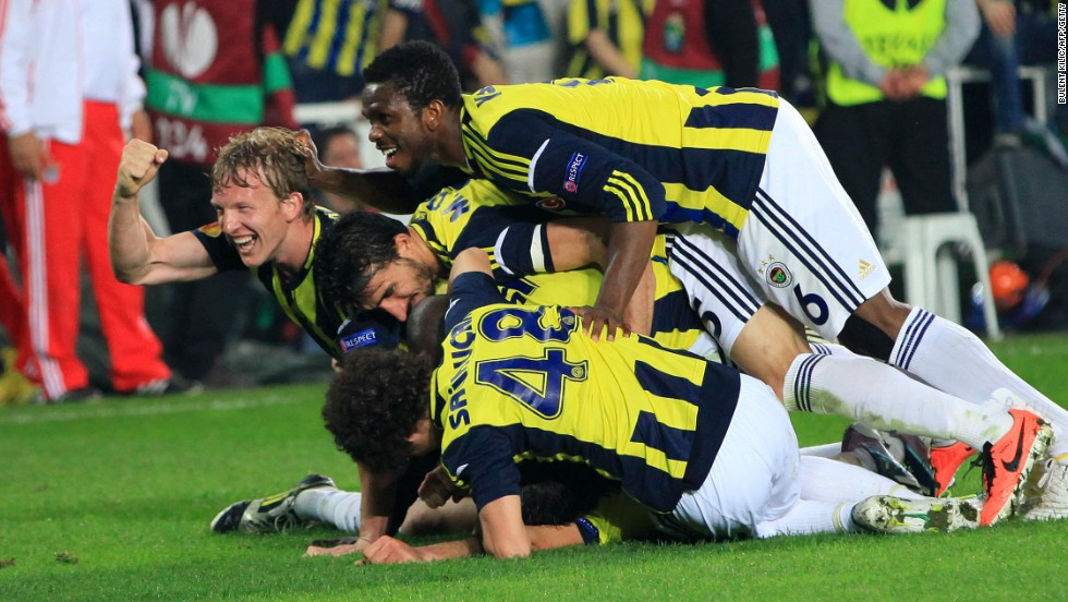Fenerbahce players celebrate their winning goal in the Europa League semifinal first leg against Benfica.