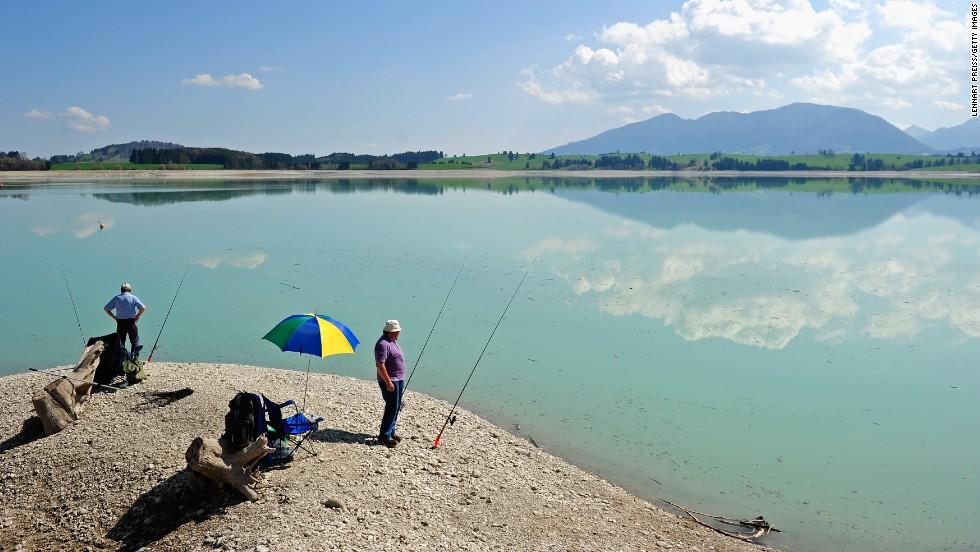 Arnold Gropper, left, and Werner Simm fish at Lake Forggensee on Thursday, April 25, near Füssen, Germany.