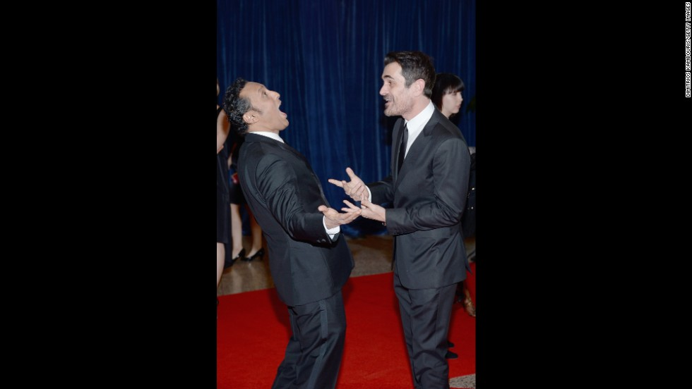 "Actor and comedian Aasif Mandvi, from ""The Daily Show,"" and Ty Burrel, from ""Modern Family,"" greet each other on the red carpet."