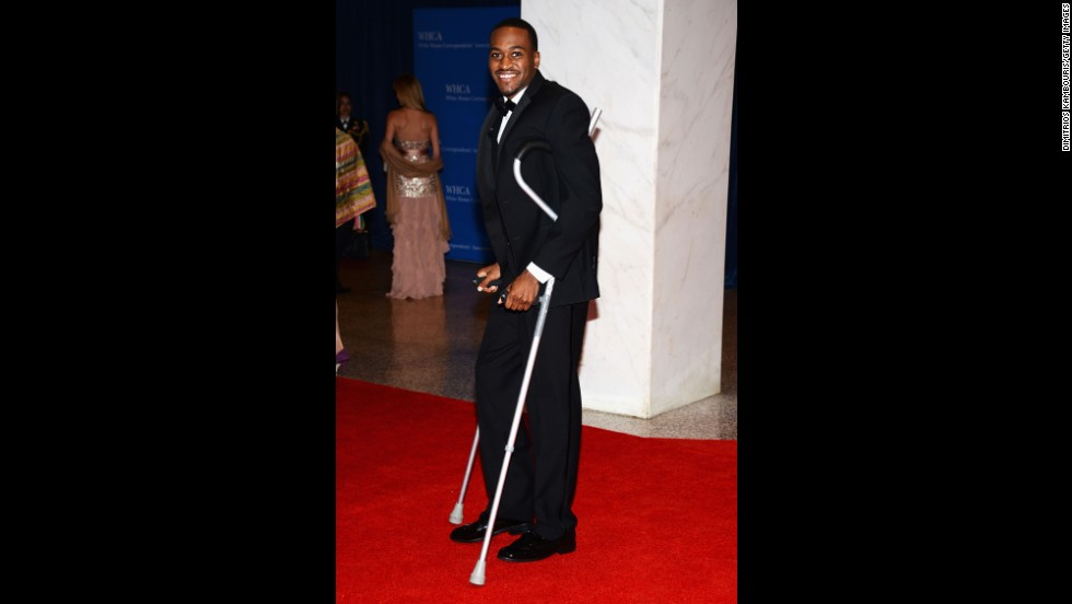 University of Louisville basketball star Kevin Ware, who broke his leg during a game against Duke, arrives on crutches.