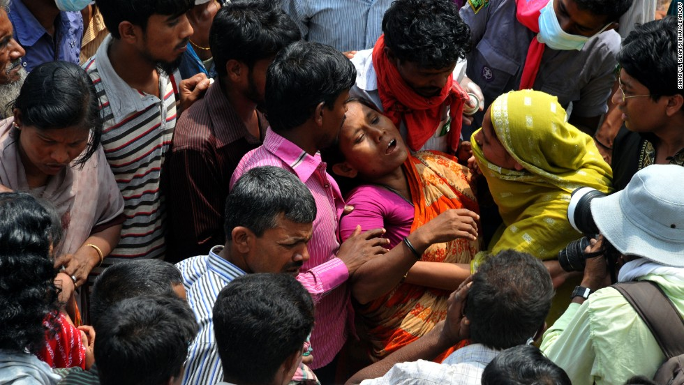 A woman mourns on April 28 at the site of the building collapse in Savar.