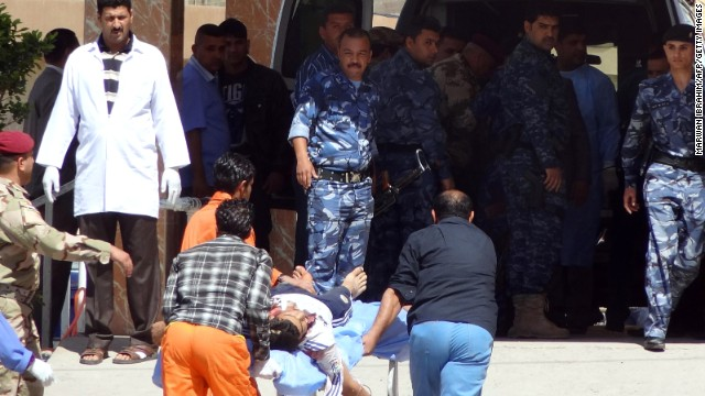 Iraqi medics wheel a man into a hospital after clashes between security forces and protesters April 23 near Kirkuk.