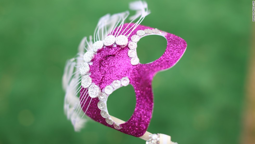 "The theme for Wilcox County High School students' first integrated prom was ""Masquerade Ball in Paris"" in 2013. The decor was a mix of Eiffel Tower images and Mardi Gras colors -- and many students wore masks, at least for a few dances."