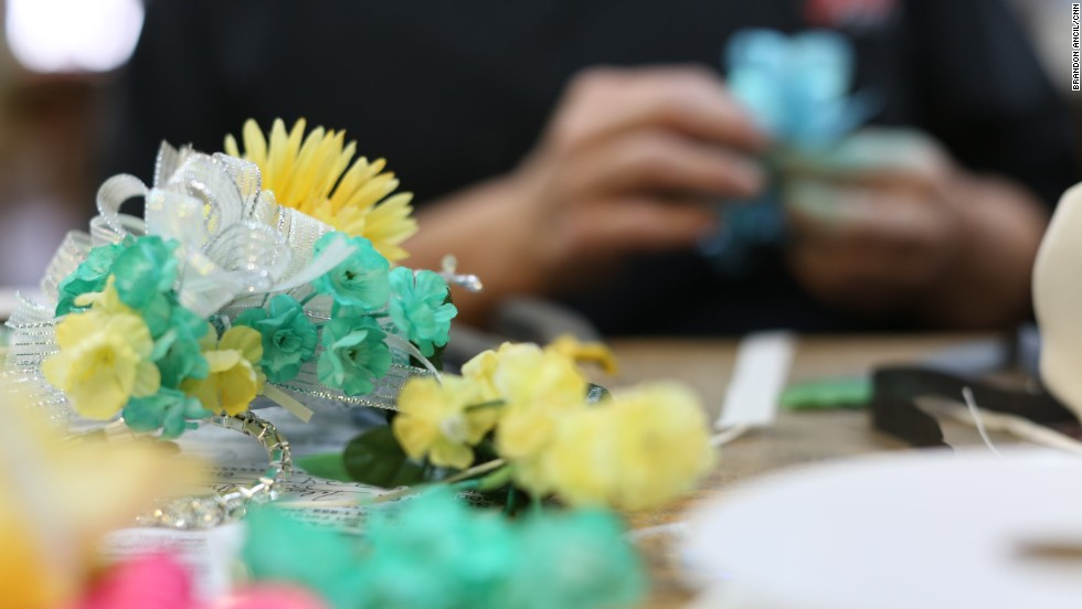 Karen Bloodworth, owner of the Rochelle Florist & Gift Shop in Wilcox County, made wrist corsages ordered by students attending the student-planned integrated prom in 2013.