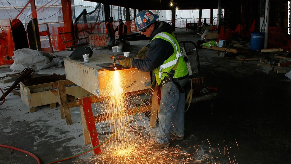A worker uses a blowtorch to cut metal near the temporary top floor of One World Trade Center on March 9, 2011.