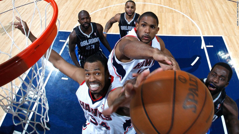 Collins, No. 34, and Al Horford of the Atlanta Hawks battle for a rebound against Brandon Bass of the Orlando Magic during Game Six of the Eastern Conference Quarterfinals in the 2011 NBA Playoffs in Atlanta.