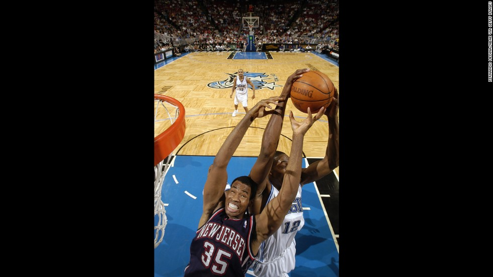 Dwight Howard of the Orlando Magic steals the ball from the Nets' Collins in 2005 in Orlando, Florida.