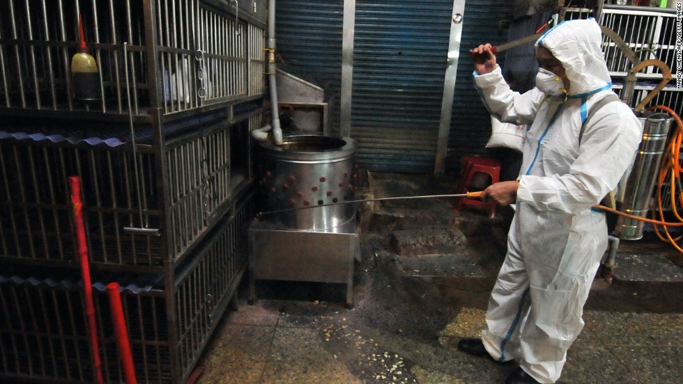 A janitor sprays disinfectant over empty chicken cages at a market in New Taipei City, Taiwan, on Monday, April 29. Asian countries have stepped up vigilance against the spread of H7N9 bird flu after a case of the deadly strain showed up in Taiwan, the first outside mainland China.
