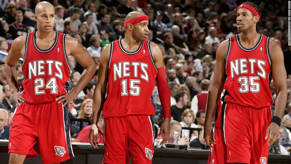 From left, Richard Jefferson, Vince Carter and Collins walk across the court during a 2007 game against the Portland Trail Blazers on in Portland, Oregon.