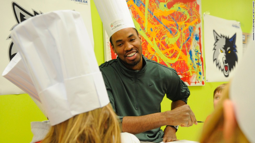 Collins, then with the Minnesota Timberwolves, helps children with diabetes prepare meals at Way Cool Cooking School in Eden Prairie, Minnesota, in 2009. He played for the Timberwolves during the 2008-09 season.
