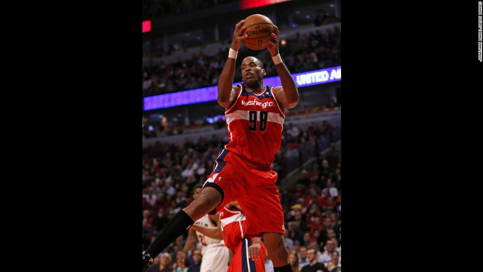 Collins, with the Washington Wizards, rebounds against the Chicago Bulls this year in Chicago. The center is now a free agent.