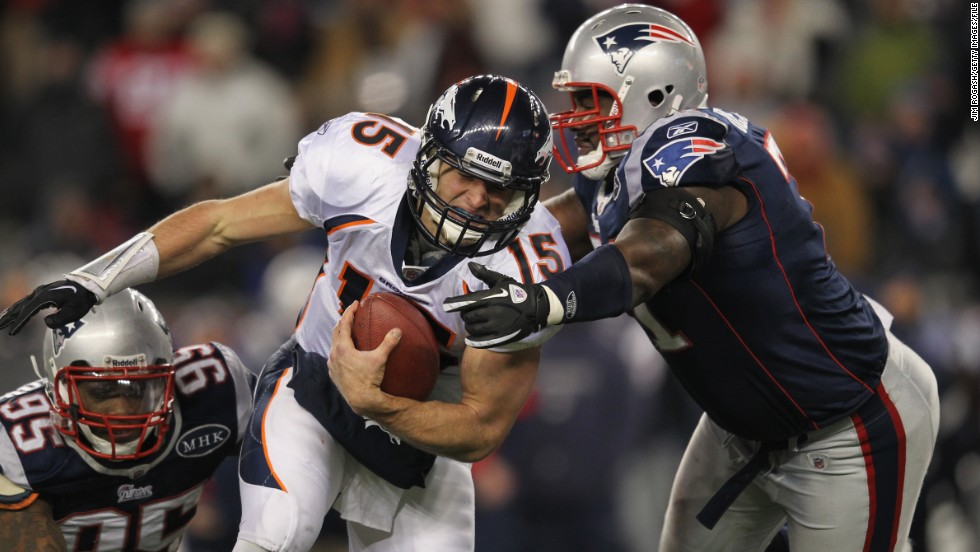 Tebow, playing for the Denver Broncos, runs the ball against the Patriots during a playoff game in January 2012. Tebow spent two seasons with the Broncos, who drafted him with a first-round pick in 2010.