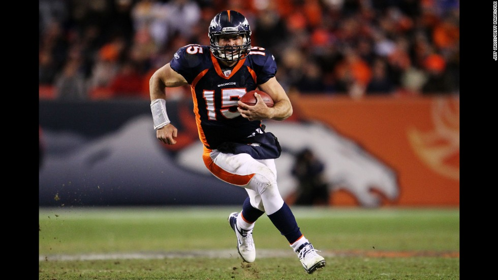 During the playoff win against Pittsburgh, Tebow scrambles before his game-winning touchdown pass to Demaryius Thomas.
