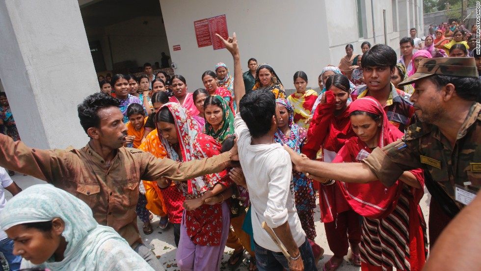 Garment workers block a street during a protest Monday, April 29.