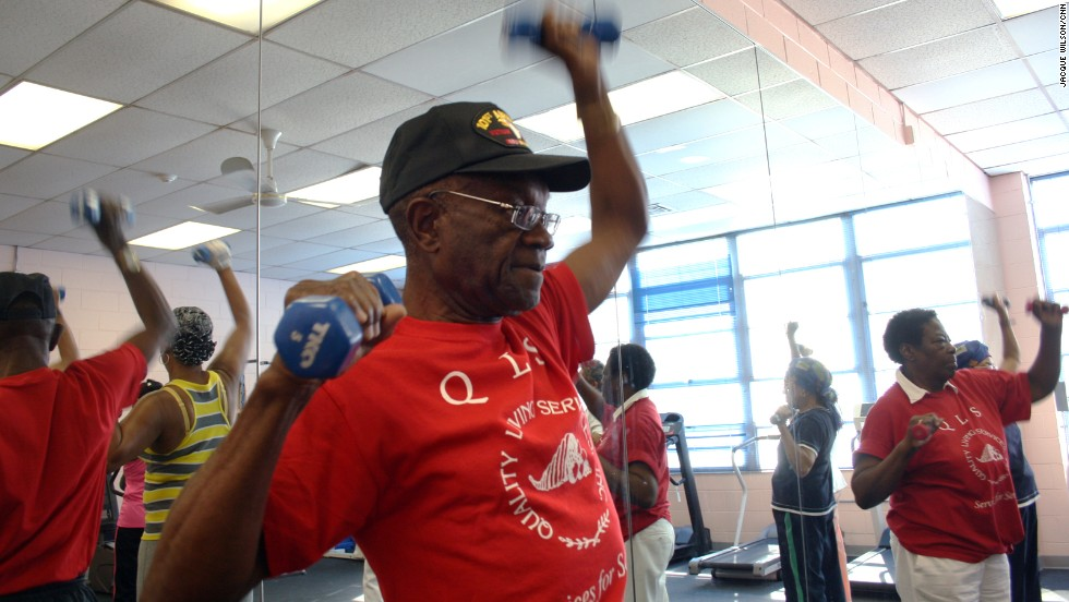 The seniors in Magnum's class use 3- to 5-pound weights for arm exercises. Pressing the weights overhead helps strengthen their shoulders and forearms, which can aid in putting away groceries or getting objects down from high shelves.