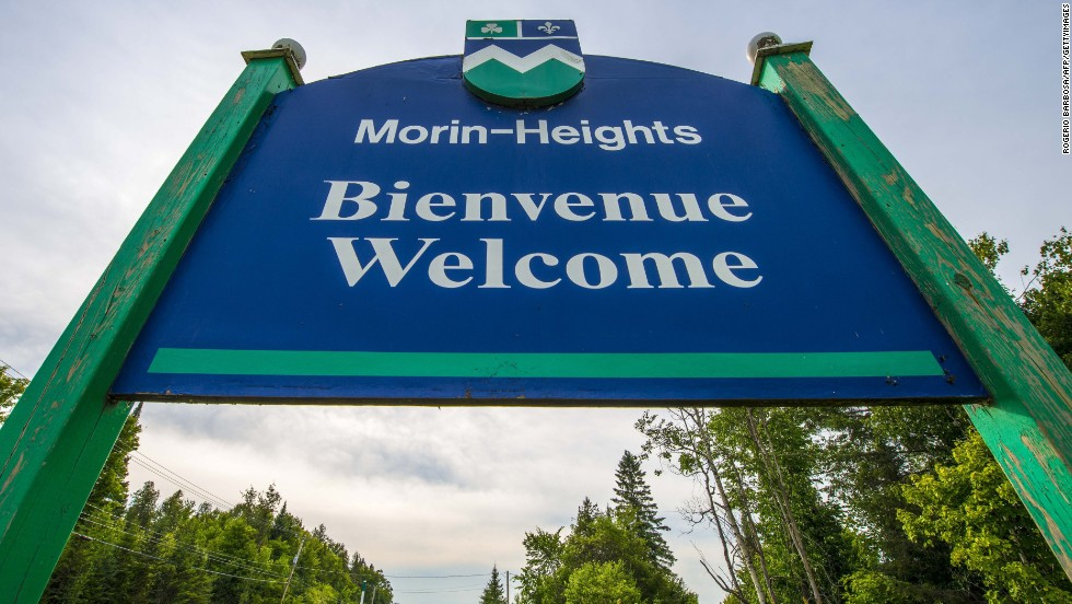 "A sign reading ""Welcome"" in French and English stands at the entrance to Morin-Heights, a tourist town in the Laurentian Mountains region of Quebec, Canada. In Quebec, French must be the predominant language on signs, retail or food service employees always greet customers in French, and there are laws dictating whether parents can send their children to English or French school."