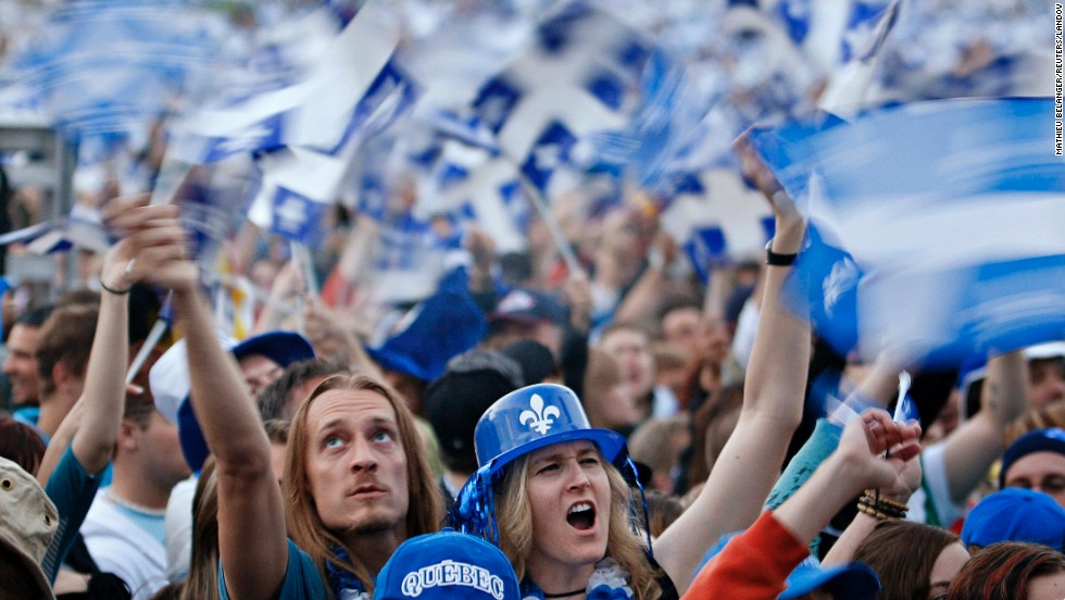 Revelers celebrate St. Jean Baptiste Day on the Plains of Abraham in Quebec City. There's a strong nationalistic component to the holiday, especially for the current minority who believe Quebec should be its own country.