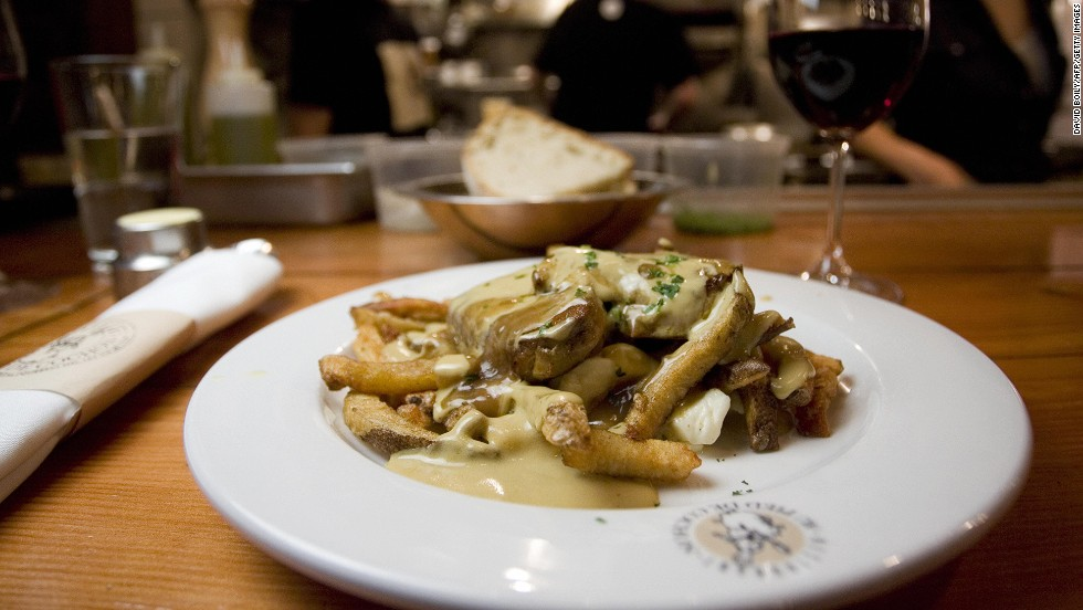 This poutine au fois gras sits on a table at Le Pied de Cochon in Montreal. Poutine is a traditional Quebecois dish consisting of fries, sauce brune (gravy) and cheese curds that's been reinvented by some upscale restaurants.
