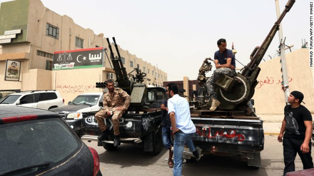 Armed men in trucks with anti-aircraft guns mounted on them occupied the Libyan Justice Ministry in Tripoli.