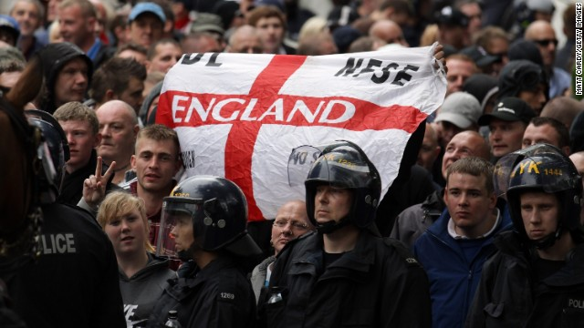 Police escort members of the English Defence League through Bristol on July 14, 2012.